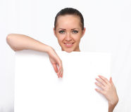 Beautiful woman holding a blank paper Stock Photography