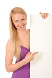 Beautiful woman holding blank poster. Beautiful young woman holding blank poster Royalty Free Stock Photo