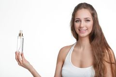 Woman holding bottle of perfume royalty free stock photo