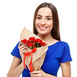 Beautiful woman holding bouquet of roses Royalty Free Stock Photos