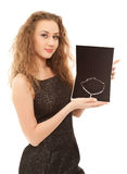 Beautiful woman holding a box with jewel Royalty Free Stock Images