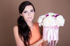 Beautiful woman holding box with peony flowers Stock Photography