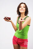 Beautiful woman holding a bunch of grapes Royalty Free Stock Image