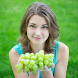 Beautiful Woman Holding Bunch Of Grapes Stock Photos