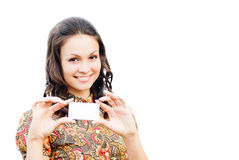 Beautiful woman holding business card with copy space. Young beautiful woman holding business card with copy space isolated over white background Royalty Free Stock Photography