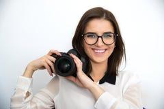 Beautiful woman holding camera Royalty Free Stock Image