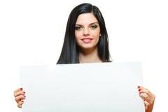 Beautiful woman holding card Royalty Free Stock Photos