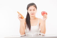 Beautiful woman holding carrot and apple Stock Images