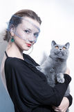 Beautiful woman holding a cat in her arms Royalty Free Stock Image