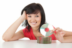 Beautiful woman holding a CD or Blue Ray DVD Stock Image