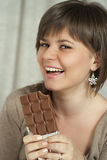 beautiful woman holding a chocolate bar Royalty Free Stock Photos
