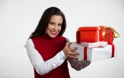 Beautiful woman holding Christmas gifts Stock Photo