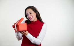 Beautiful woman holding Christmas gifts Stock Photos
