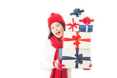Beautiful woman holding christmas gifts happy and excited Royalty Free Stock Photo