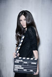 Beautiful woman holding clapperboard Royalty Free Stock Image
