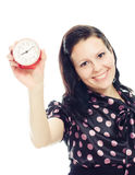 Beautiful woman holding a clock . Royalty Free Stock Photo