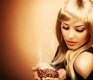 Beautiful woman holding coffee bean Royalty Free Stock Image