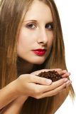 Beautiful woman holding coffee beans in her hands Stock Images