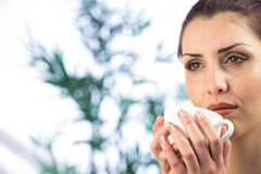 Beautiful woman holding coffee cup Royalty Free Stock Image