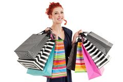 Beautiful woman holding colorful bags stock photography