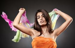Beautiful woman holding colorful scarf Stock Photo