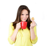 Beautiful woman holding cookies and coffee against white backgro Royalty Free Stock Images