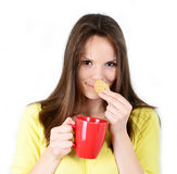 Beautiful woman holding cookies and coffee against white backgro Royalty Free Stock Photography