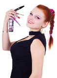 Beautiful woman holding cosmetics Stock Photos