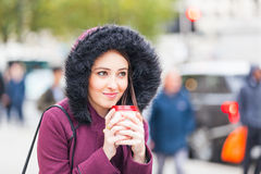 Beautiful woman holding a cuf of tea in London Royalty Free Stock Photos