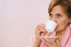 Beautiful woman holding a cup Royalty Free Stock Image