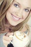 Beautiful woman holding cup of coffee Royalty Free Stock Photography