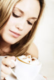 Beautiful woman holding cup of coffee royalty free stock photo
