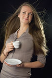 Beautiful woman holding cup of coffee Stock Images