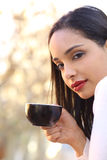 Beautiful woman holding a cup of coffee outdoor Stock Images