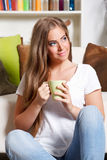 Beautiful woman holding a cup of drink Royalty Free Stock Photos