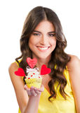 Beautiful woman holding a cupcake Royalty Free Stock Photography