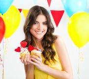 Beautiful woman holding a cupcake Stock Photo