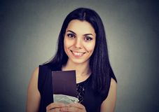 Beautiful woman holding a dark chocolate bar feeling happy royalty free stock image