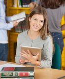Beautiful Woman Holding Digital Tablet In Library Stock Images