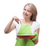 Beautiful woman holding a dish for a delicious meal solated on w Royalty Free Stock Photos