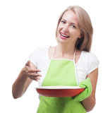 Beautiful woman holding a dish for a delicious meal solated on w Stock Photo
