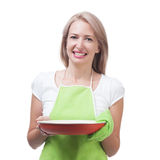 Beautiful woman holding a dish for a delicious meal solated on w Stock Photos