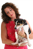 Beautiful Woman Holding Dog. Over white background royalty free stock images