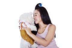 Beautiful woman holding dog on the studio Stock Photo