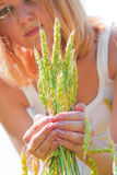 Beautiful woman holding ears of wheat Royalty Free Stock Images