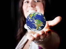 Beautiful woman holding the Earth Stock Image