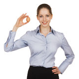 Beautiful woman holding an egg in his hand Royalty Free Stock Images