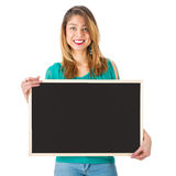 Beautiful woman holding empty chalkboard in front of her body stock photos