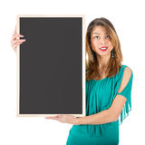 Beautiful woman holding empty chalkboard beside of her body royalty free stock images