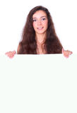 Beautiful woman holding empty white board Royalty Free Stock Images